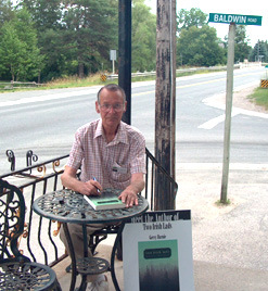 "Gerry Burnie, winner of the iUniverse Editor's Choice, Publisher's Choice, and Readeer's Choice awards, for his novel ""Two Irish Lads."" Seen here at a book signing at Baldwin, Ontario."