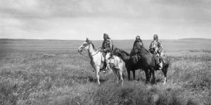 Three Piegan Blacckfoot chiefs on the prairies of Montana.